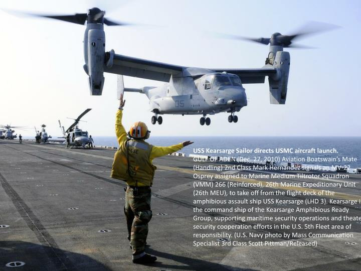 USS Kearsarge Sailor directs USMC aircraft launch.