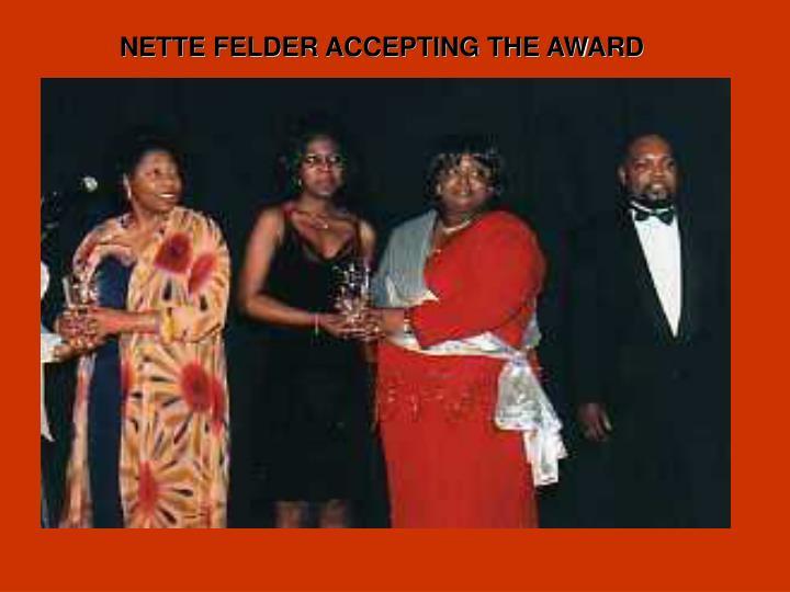 NETTE FELDER ACCEPTING THE AWARD
