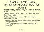 orange temporary markings in construction zones