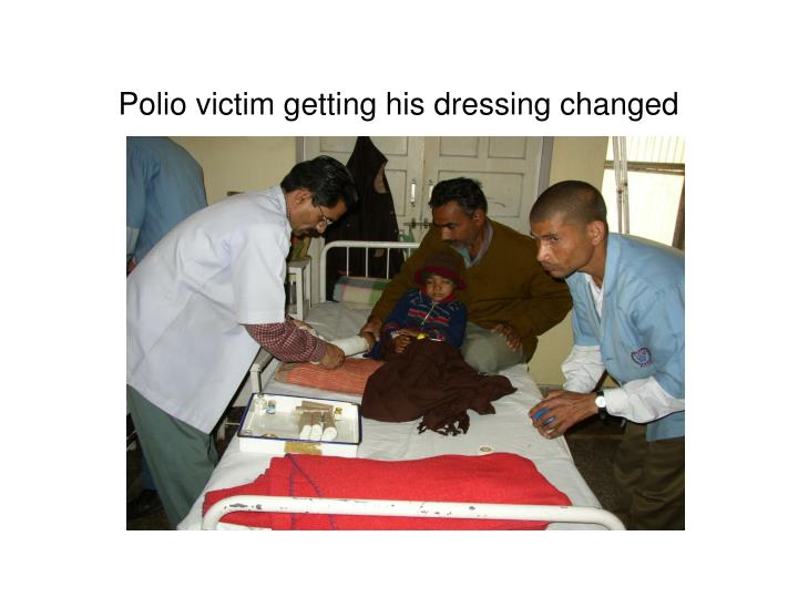 Polio victim getting his dressing changed