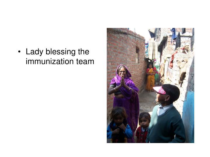 Lady blessing the immunization team