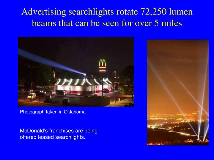 Advertising searchlights rotate 72,250 lumen beams that can be seen for over 5 miles
