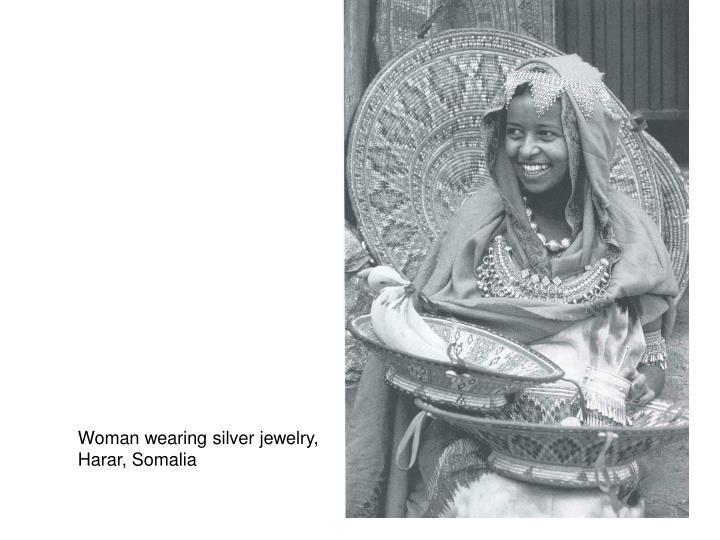 Woman wearing silver jewelry,