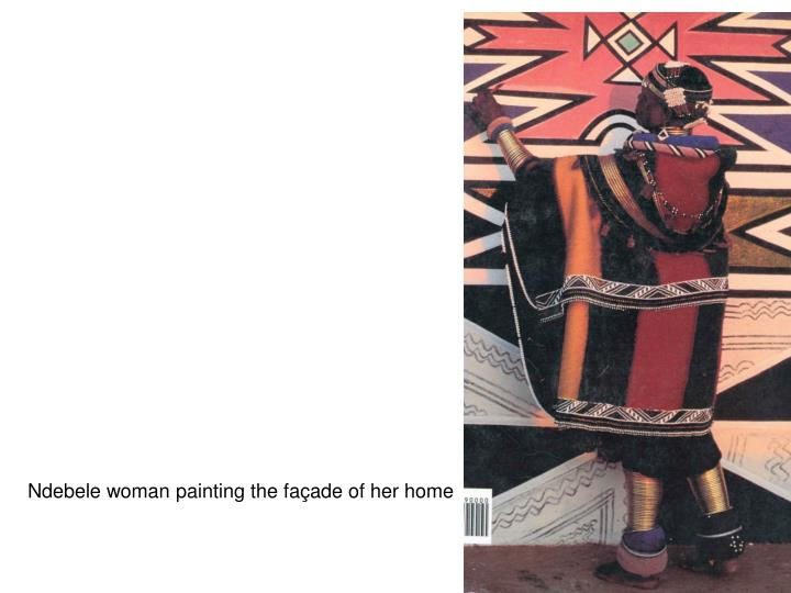 Ndebele woman painting the façade of her home