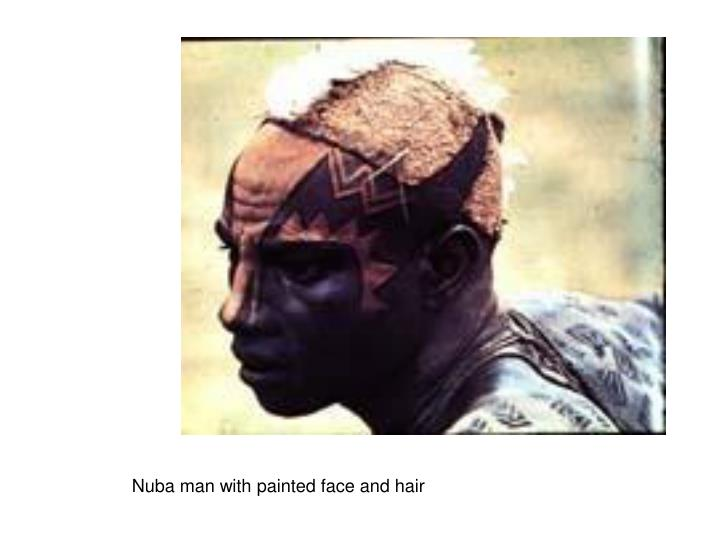 Nuba man with painted face and hair
