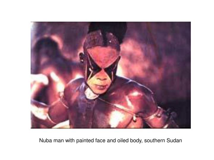 Nuba man with painted face and oiled body, southern Sudan