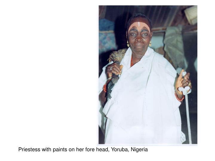 Priestess with paints on her fore head, Yoruba, Nigeria