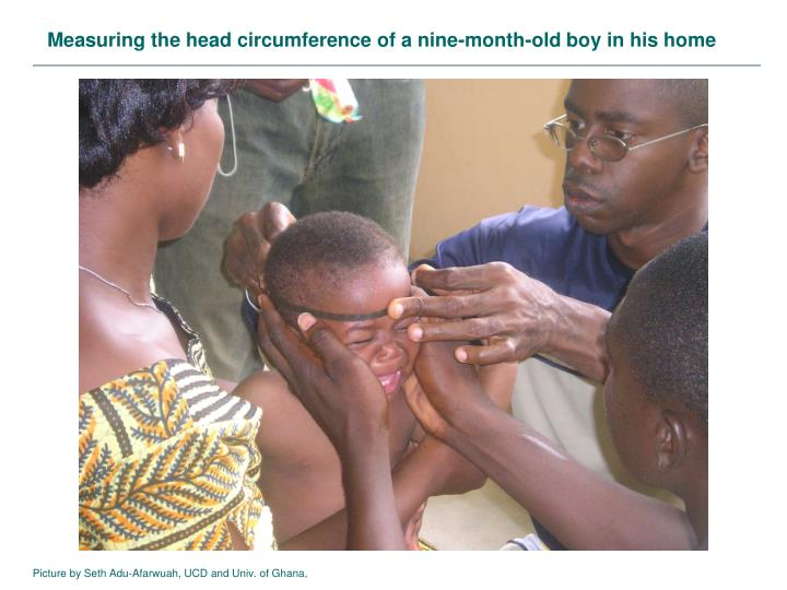 Measuring the head circumference of a nine-month-old boy in his home