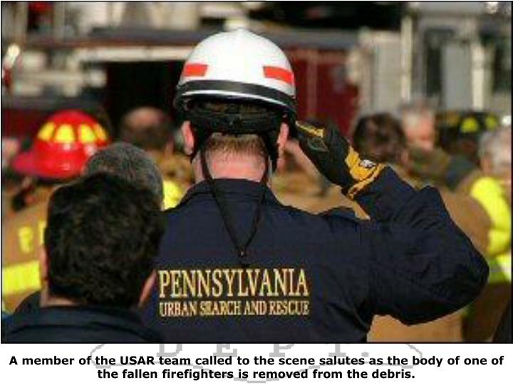 A member of the USAR team called to the scene salutes as the body of one of the fallen firefighters is removed from the debris.