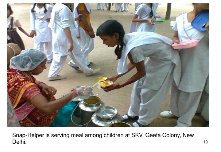 Snap-Helper is serving meal among children at SKV, Geeta Colony, New Delhi.