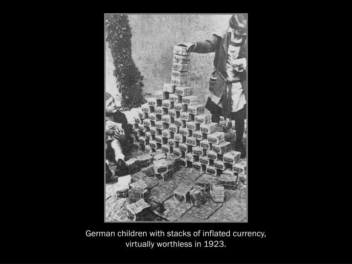 German children with stacks of inflated currency,  virtually worthless in 1923.