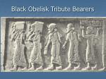 black obelisk tribute bearers