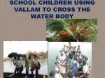 school children using vallam to cross the water body