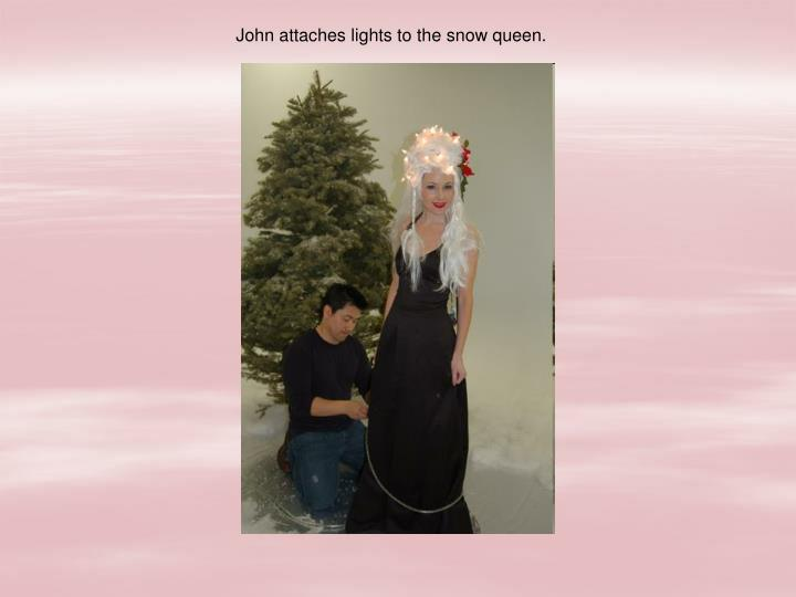 John attaches lights to the snow queen.