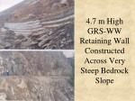 4 7 m high grs ww retaining wall constructed across very steep bedrock slope