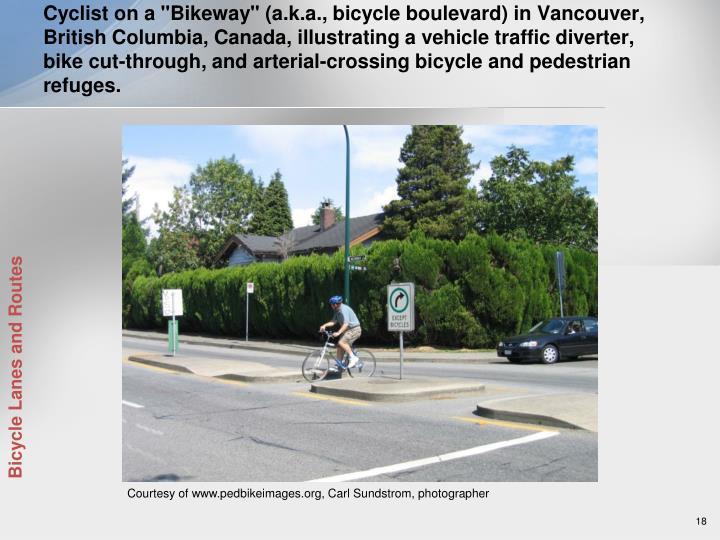 """Cyclist on a """"Bikeway"""" (a.k.a., bicycle boulevard) in Vancouver, British Columbia, Canada, illustrating a vehicle traffic diverter, bike cut-through, and arterial-crossing bicycle and pedestrian refuges."""