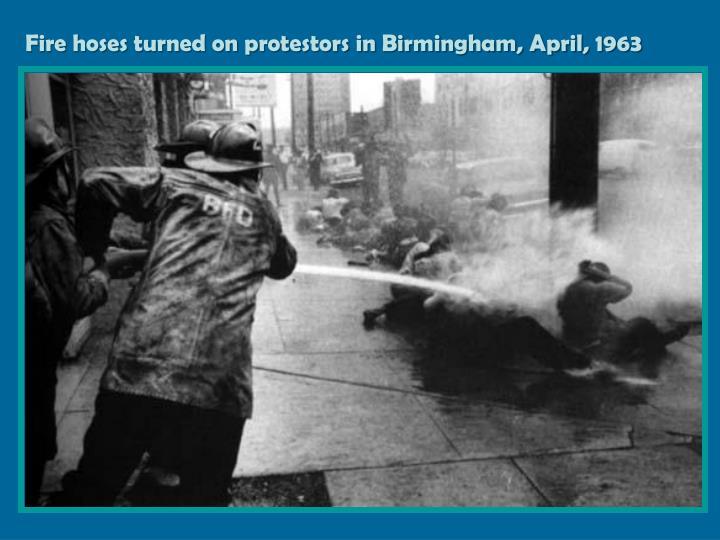 Fire hoses turned on protestors in Birmingham, April, 1963
