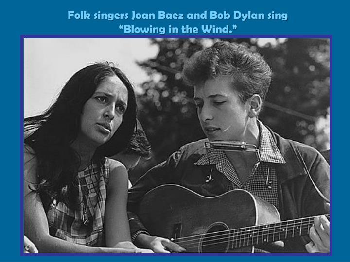 "Folk singers Joan Baez and Bob Dylan sing ""Blowing in the"
