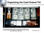 organizing the cash drawer till