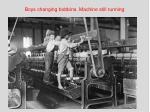 boys changing bobbins machine still running