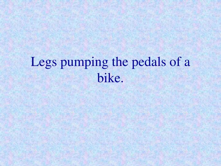 Legs pumping the pedals of a bike.