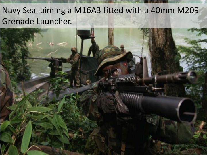 Navy Seal aiming a M16A3 fitted with a 40mm M209 Grenade Launcher.