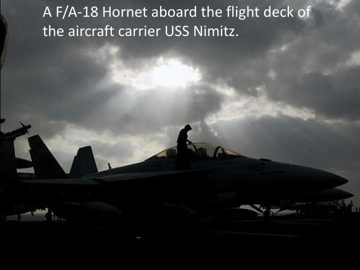 A F/A-18 Hornet aboard the flight deck of the aircraft carrier USS Nimitz.