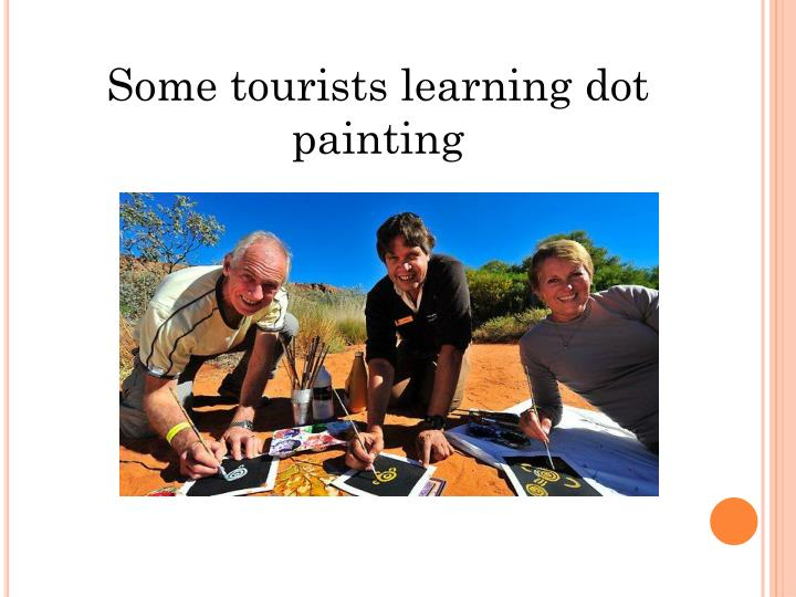 Some tourists learning dot painting