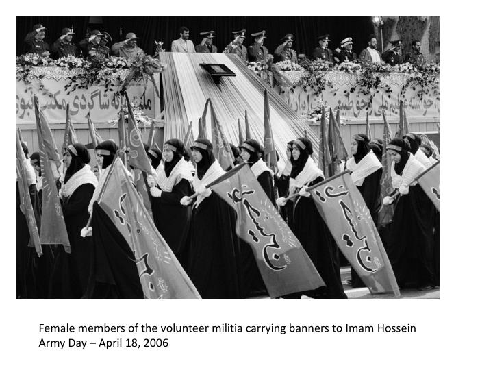 Female members of the volunteer militia carrying banners to Imam