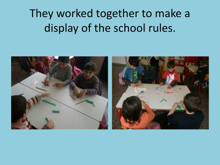 They worked together to make a display of the school rules.