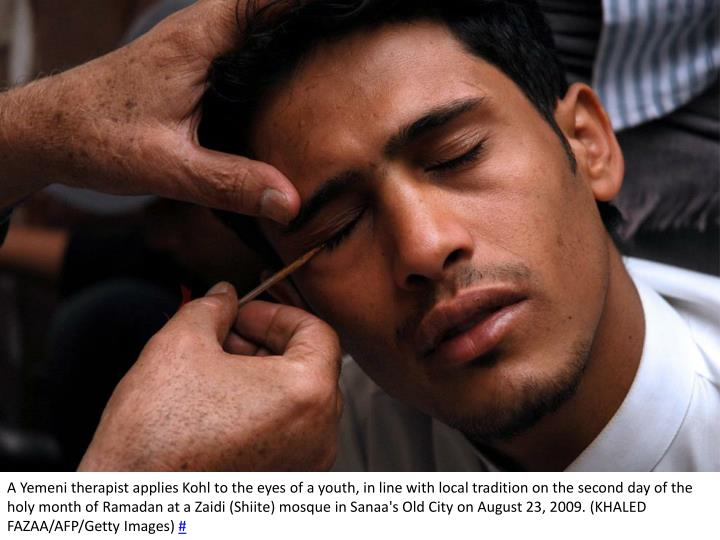 A Yemeni therapist applies Kohl to the eyes of a youth, in line with local tradition on the second day of the holy month of Ramadan at a