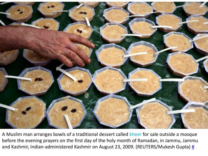 A Muslim man arranges bowls of a traditional dessert called