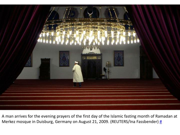 A man arrives for the evening prayers of the first day of the Islamic fasting month of Ramadan at