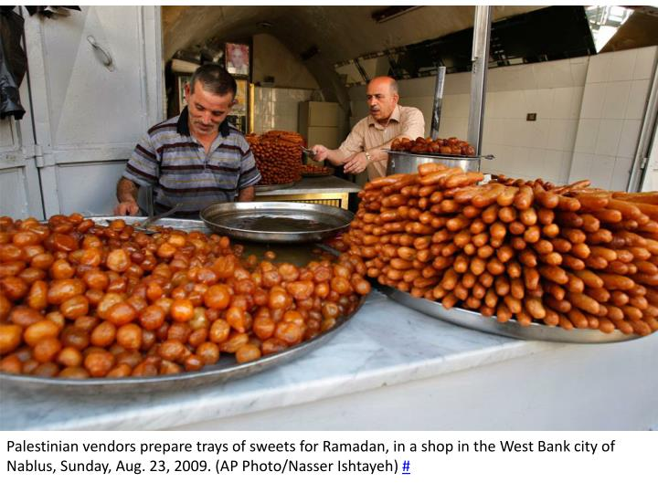 Palestinian vendors prepare trays of sweets for Ramadan, in a shop in the West Bank city of Nablus, Sunday, Aug. 23, 2009. (AP Photo/Nasser