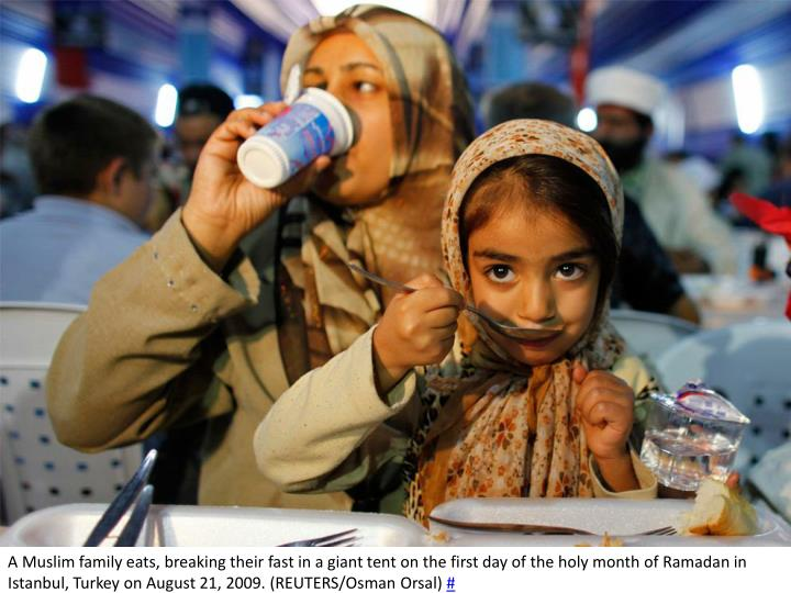 A Muslim family eats, breaking their fast in a giant tent on the first day of the holy month of Ramadan in Istanbul, Turkey on August 21, 2009. (REUTERS/