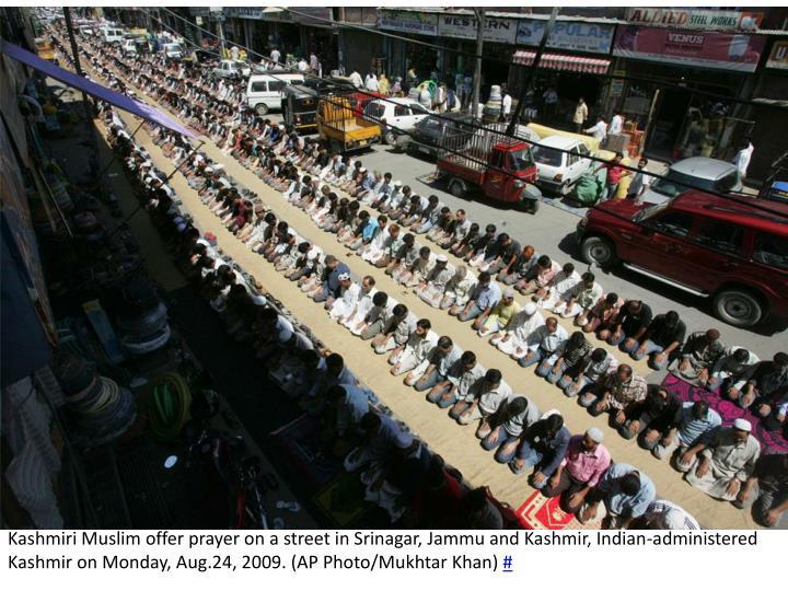 Kashmiri Muslim offer prayer on a street in Srinagar, Jammu and Kashmir, Indian-administered Kashmir on Monday, Aug.24, 2009. (AP Photo/
