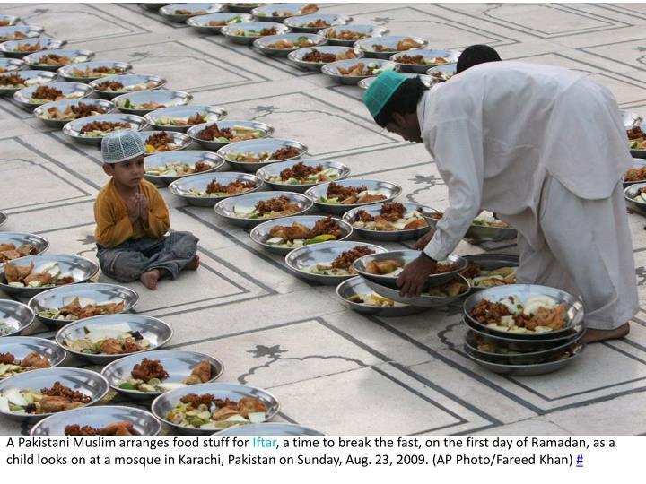 A Pakistani Muslim arranges food stuff for