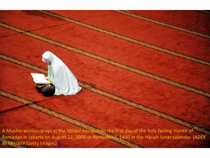 A Muslim woman prays at the