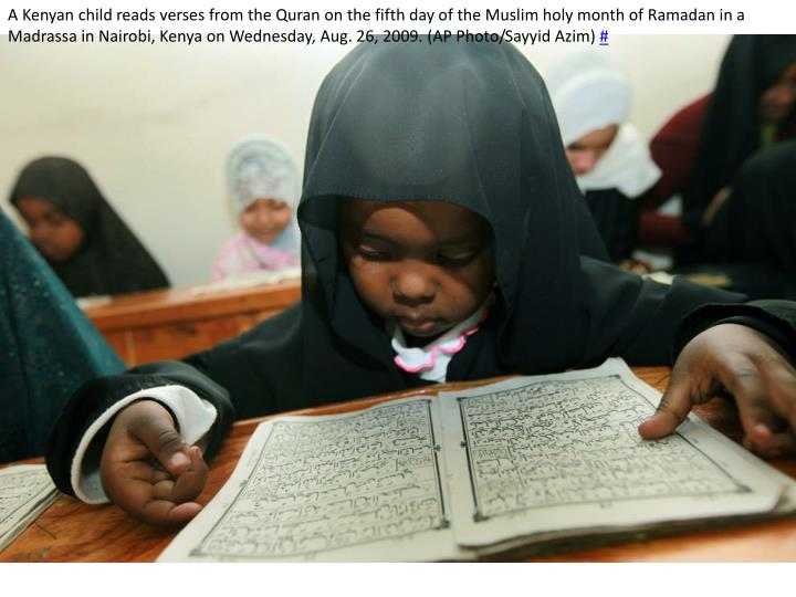 A Kenyan child reads verses from the Quran on the fifth day of the Muslim holy month of Ramadan in a