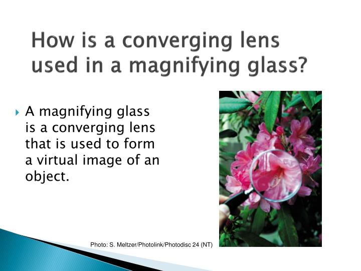 How is a converging lens used in a magnifying glass?
