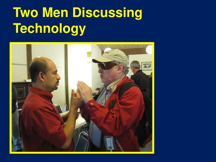 Two Men Discussing Technology