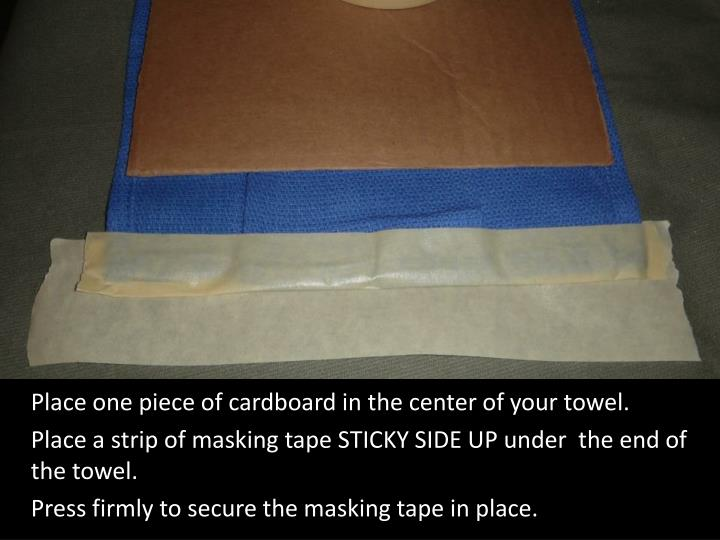 Place one piece of cardboard in the center of your towel.