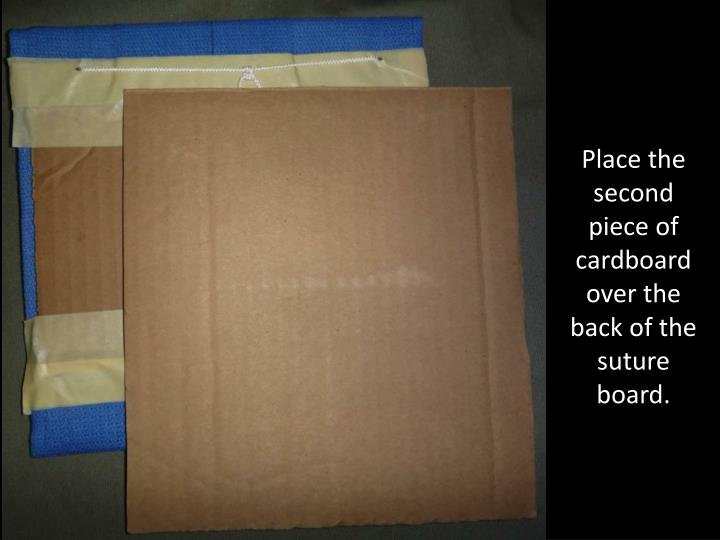 Place the second piece of cardboard over the back of the suture board.
