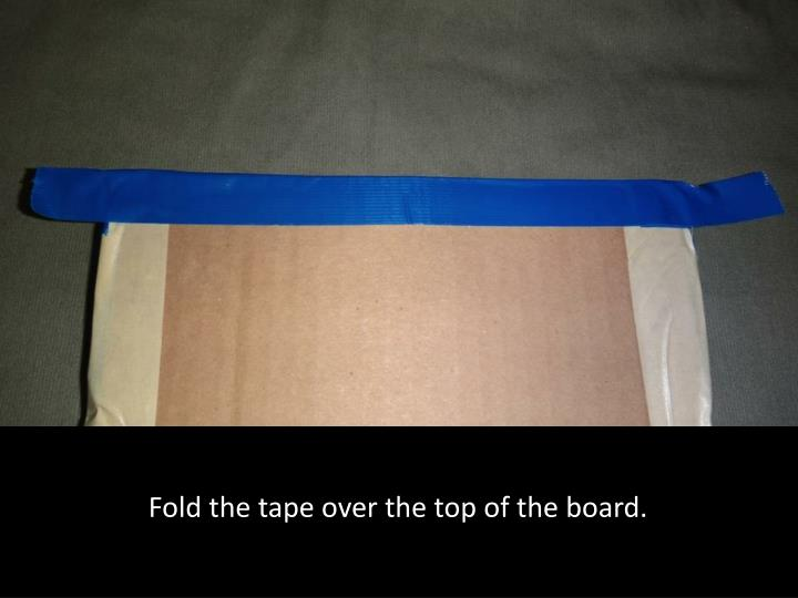 Fold the tape over the top of the board.