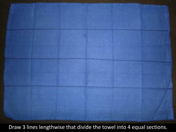 Draw 3 lines lengthwise that divide the towel into 4 equal sections.