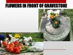flowers in front of gravestone