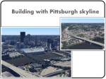 building with pittsburgh skyline