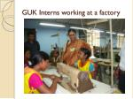 guk interns working at a factory