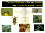 the use of black and yellow as a warning sign resembling poisinous species