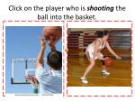click on the player who is shooting the ball into the basket